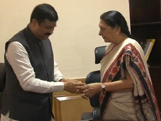 Rakhi to Minister Dharmendra Pradhan by Anandiben