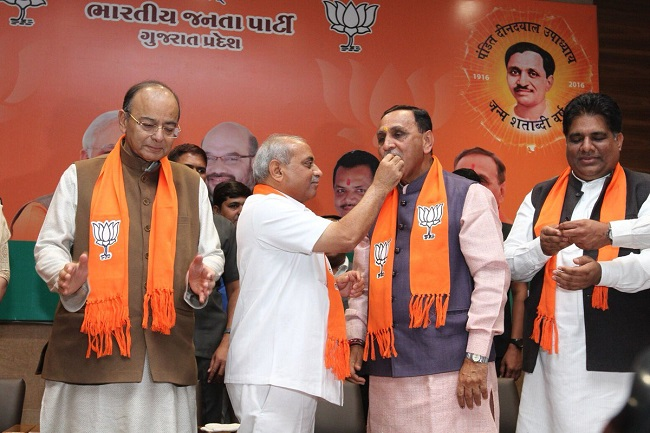 nitin patel offer sweets to bjp leaders