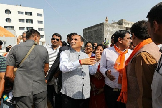vijay rupani flying kite on uttarayan