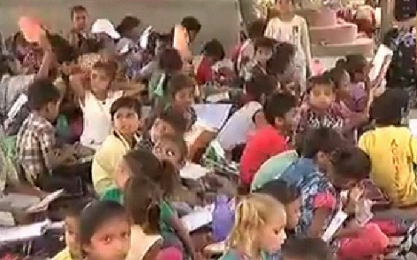 pipalaj students sitting under hot sun