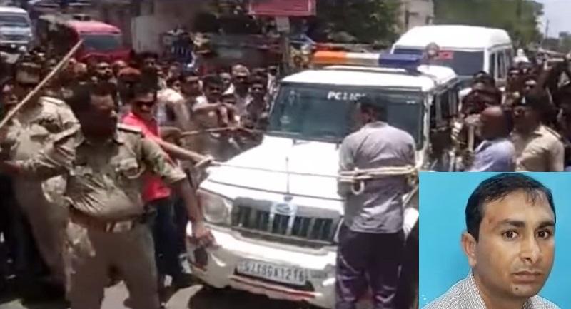 bhavnagar rapist teacher beaten by police in public
