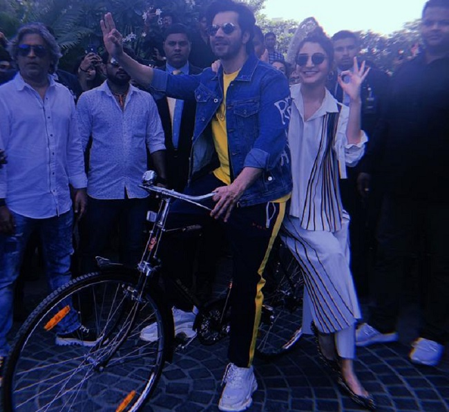 varun and anushka on bicycle