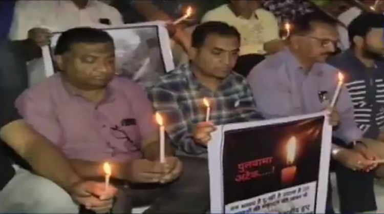 candle march protest in ahmedabad